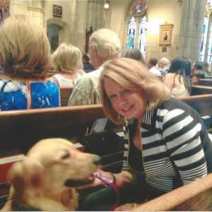 Bev Broberg, Director, Genesis Assistance Dogs, Inc. and Wally attend church.