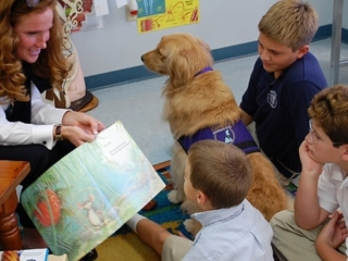 Helping to improve reading skills at Rosarian Academy.
